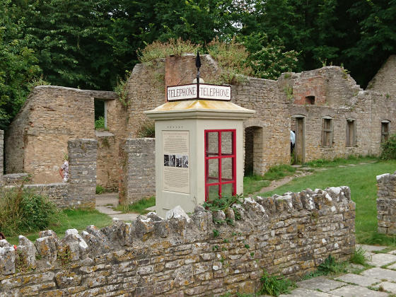 An old-fashioned telephone box inside a ruin