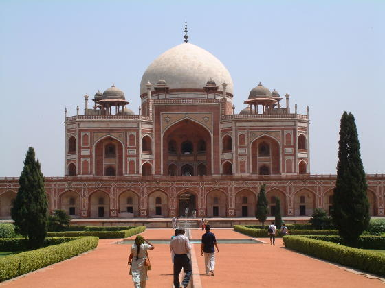 A building looking like a smaller version of the Taj Mahal in white and red brick
